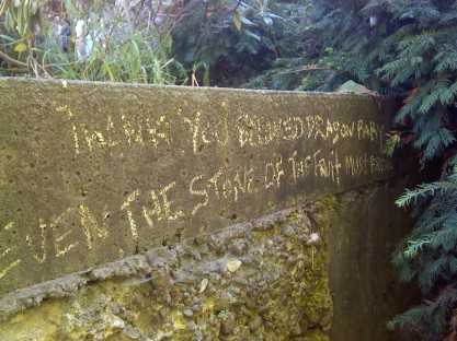 "An interesting bit of graffiti along the bank of the river: ""Thank you Beloved Dragon Baby/Even the stone of the fruit must break"""