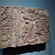 "Relief with Arsinoe II, Ptolemaic, c. 180 BCE. Arsinoe II reigned as queen with her brother-husband Ptolemy II (ruled 285-246 BCE). They were worshipped as the Theoi Adelphoi (Sibling Gods), and after her death in 270 BCE the king instituted a special cult for her throughout Egypt. In this relief from a temple probably in Memphis, she wears an elaborate crown that was created specifically for her and adopted by later Ptolemaic queens. The hieroglyphic inscriptions, ""Arsinoe, daughter of Amun"" and ""beloved of the gods,"" suggest that this is a posthumous image."